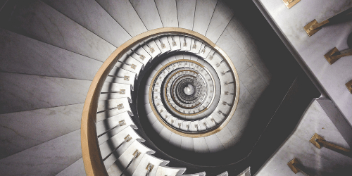 Looking down a spiral staircase into the unknown